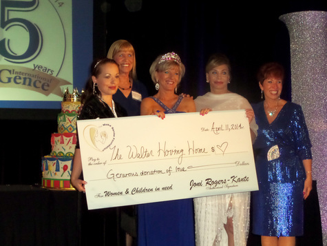 Jeri Taylor-Swade along with Joni Rogers-Kante, CEO of SeneGence presenting a donation on stage to the Walter Hoving Home of Las Vegas